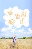 Il ragazzino accanto valize con la bolla di pensiero dentro Fotografia Stock Libera da Diritti