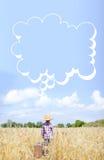 Il ragazzino accanto valize con la bolla di pensiero dentro Fotografia Stock