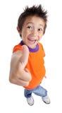 Il ragazzino che gesturing i pollici aumenta il segno Fotografia Stock