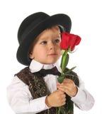 Il ragazzino con è aumentato Fotografie Stock