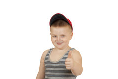 Il ragazzino ha allungato fuori la sua mano con il pollice Fotografie Stock Libere da Diritti