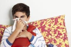 Il ragazzino ha il raffreddore Fotografie Stock