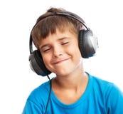 Il ragazzo è gode della musica Fotografia Stock