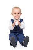 Il ragazzo applaude le sue mani Immagine Stock
