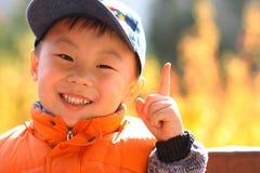 Il ragazzo asiatico funge da vittoria Fotografia Stock Libera da Diritti
