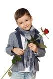 Il ragazzo con è aumentato Fotografia Stock