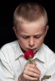 Il ragazzo con colore rosso è aumentato Fotografie Stock Libere da Diritti