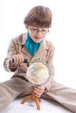 Il ragazzo con il globo Fotografie Stock