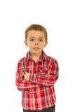 Il ragazzo del bambino con le mani ha attraversato Immagine Stock Libera da Diritti