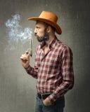Il ragazzo della mucca soffia sulla pistola fotografia stock