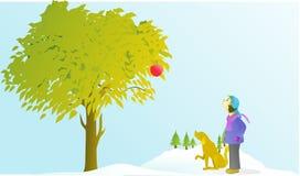 Il ragazzo ed il cane di Gg stanno esaminando le mele nell'inverno Fotografia Stock Libera da Diritti