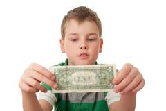 Il ragazzo giudica un dollaro in entrambe le mani isolato Fotografia Stock Libera da Diritti