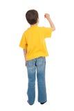 Il ragazzo in maglietta gialla scrive Fotografie Stock
