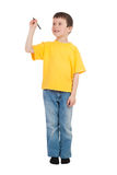 Il ragazzo in maglietta gialla scrive Fotografia Stock Libera da Diritti