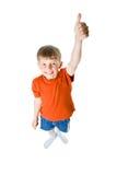 Il ragazzo mostra il suo pollice Fotografie Stock