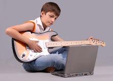 Il ragazzo musicale Fotografia Stock