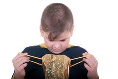 Il ragazzo osserva in un sacchetto Immagini Stock
