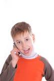 Il ragazzo parla dal telefono Fotografia Stock