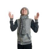 Il ragazzo sveglio dell'adolescente in maglione grigio sopra bianco ha isolato il fondo Immagine Stock Libera da Diritti