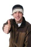 Il ragazzo teenager che dà i pollici aumenta il segno Fotografie Stock