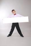 Il ragazzo tiene la scheda bianca Fotografie Stock