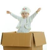Il ragazzo in un vestito di un coniglio Fotografia Stock