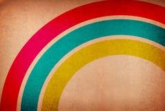 Il Rainbow gradice gli strati di colore contro un backgro grungy Fotografia Stock