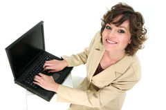 Il rappresentante di servizio comunica sopra il suo computer portatile Fotografie Stock Libere da Diritti