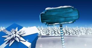 Il regalo ed il cartello di legno nell'inverno di Natale abbelliscono Fotografia Stock Libera da Diritti