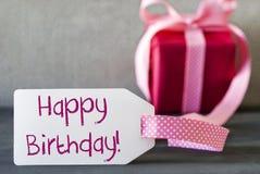 Il regalo rosa, etichetta, manda un sms al buon compleanno Fotografia Stock