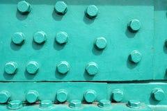 Il ribattino su metallo irradia il fondo Fotografia Stock Libera da Diritti