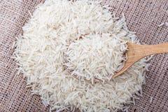 Il riso crudo è sparso Fotografia Stock Libera da Diritti