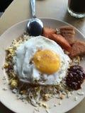 Il riso fritto di cinese con l'uovo e la carne di maiale del bbq carbonizzano siew ed il luncheon meat Fotografia Stock