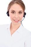 Il ritratto dei giovani allegri sorridenti sostiene l'operatore del telefono in cuffia avricolare, isolata sopra fondo bianco immagini stock