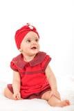 Il ritratto della neonata dolce si è vestito nel divertiresi rosso Fotografia Stock Libera da Diritti