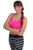 Il ritratto sorridente della donna di sport di forma fisica di allenamento adatto dimagrisce isolato Fotografie Stock Libere da Diritti