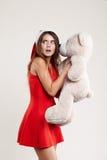 Il ritratto verticale del giocattolo della ragazza di natale riguarda il fondo bianco Fotografia Stock Libera da Diritti