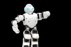 Il robot moderno con una mano sollevata e l'ardore osserva Fotografia Stock