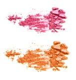 Il rosa e l'arancia hanno schiacciato gli ombretti isolati su fondo bianco Immagine Stock