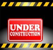 Il rosso in costruzione di progresso plat il segno Fotografia Stock Libera da Diritti