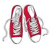 Il rosso di vettore mette in mostra le scarpe da tennis con i pizzi bianchi Fotografia Stock Libera da Diritti