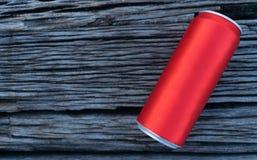 Il rosso inscatolato sulla tavola di legno fotografia stock