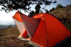 Il rosso tende sul tramonto Fotografie Stock Libere da Diritti