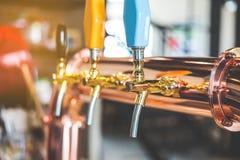 Il rubinetto della birra fotografia stock