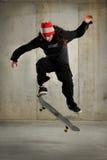 Il salto del skateboarder Immagine Stock