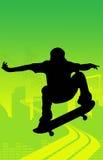 Il salto del skateboarder Fotografie Stock