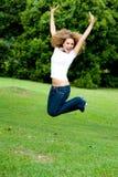 Il salto della ragazza Fotografia Stock