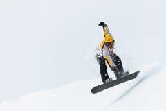 Il salto dello Snowboarder Fotografie Stock