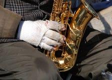 Il sassofonista anziano Immagini Stock