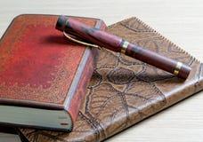 Il scrittura-libro in un cuoio Fotografia Stock
